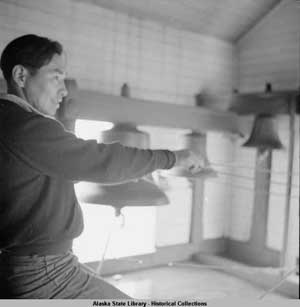 Aleut Bell Ringer at Belkofski's Holy Resurrection Church, 1938. Credit: Alaska State Library—Historical Collections, Evelyn Butler and George Dale, Photographs, 1932–1982.